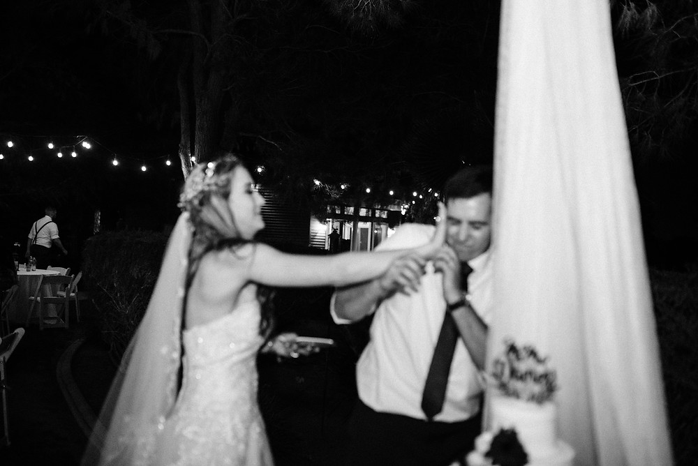 bride smashes cake into grooms face
