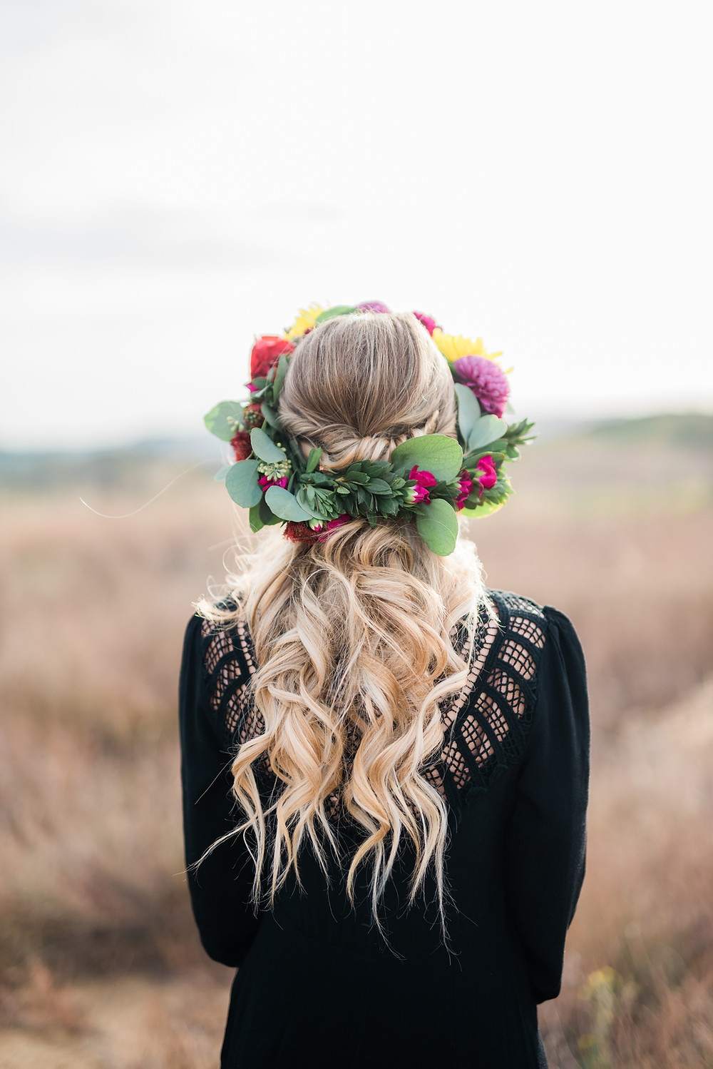 bride with black wedding dress and flower crown in temecula