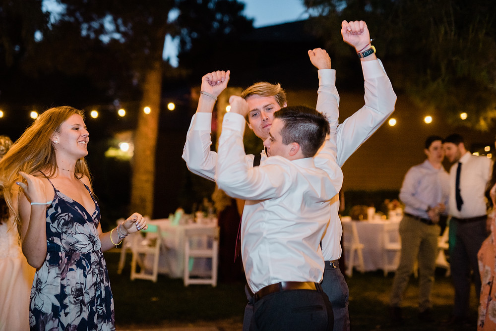 groom at wedding reception parting and having fun