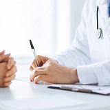 Doctor-with-pen-patient-with-hands-clasp