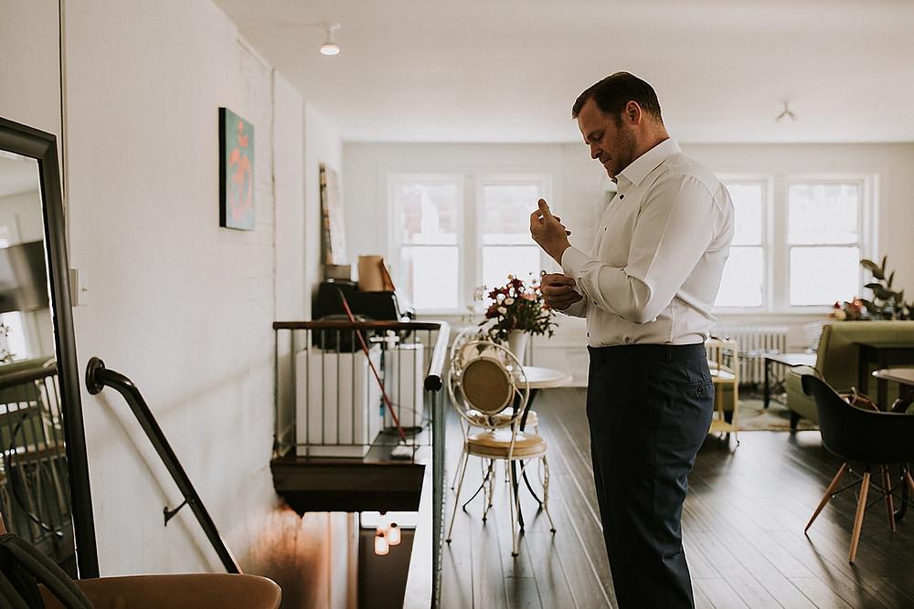 Groom preparing before wedding