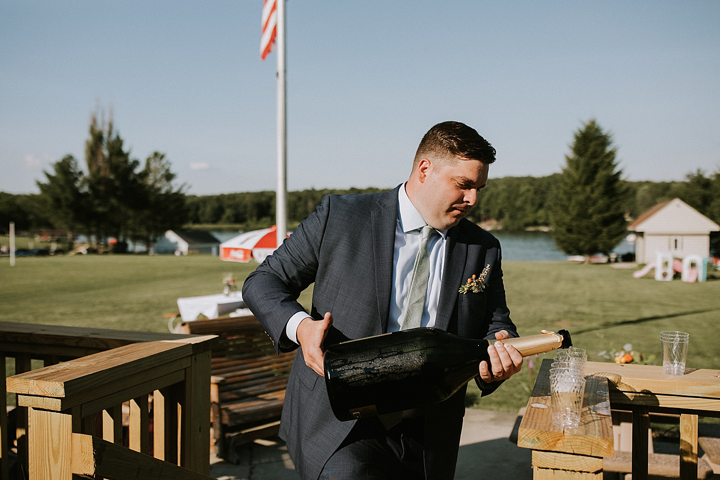 Groomsmen pouring a giant bottle of champagne