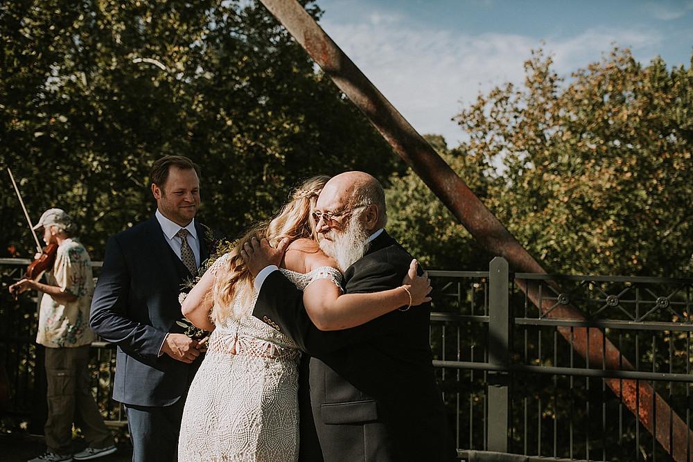 Bride and her dad hugging