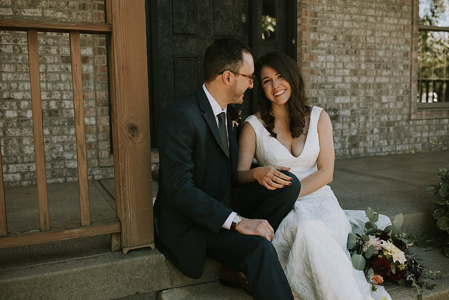 Wedding portraits on front porch of home