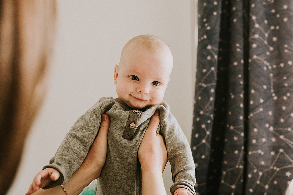 smiling baby in family photos