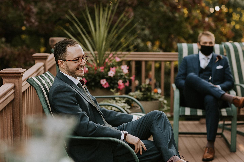 Groom talking to guests before wedding