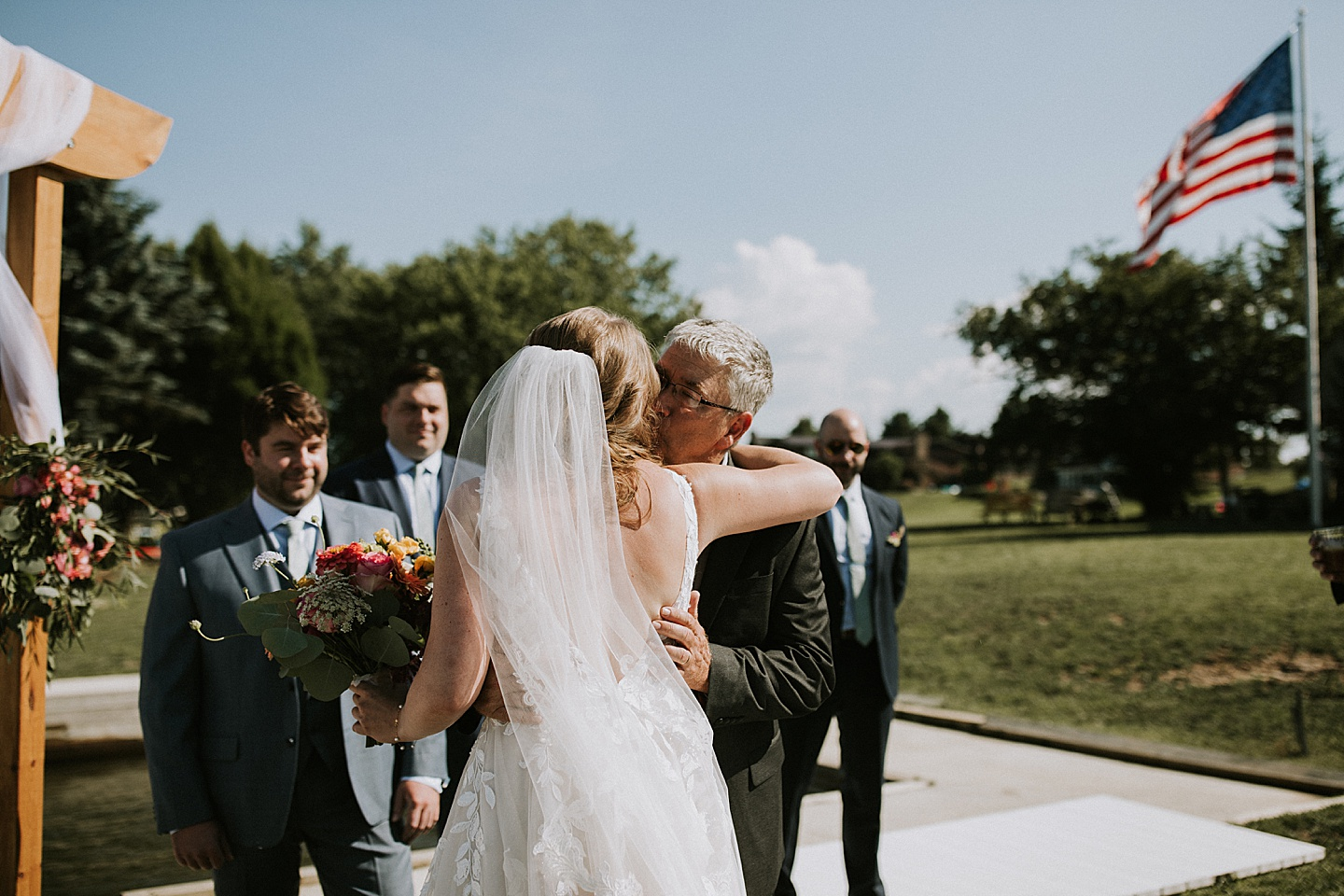Fathering giving away daughter at wedding