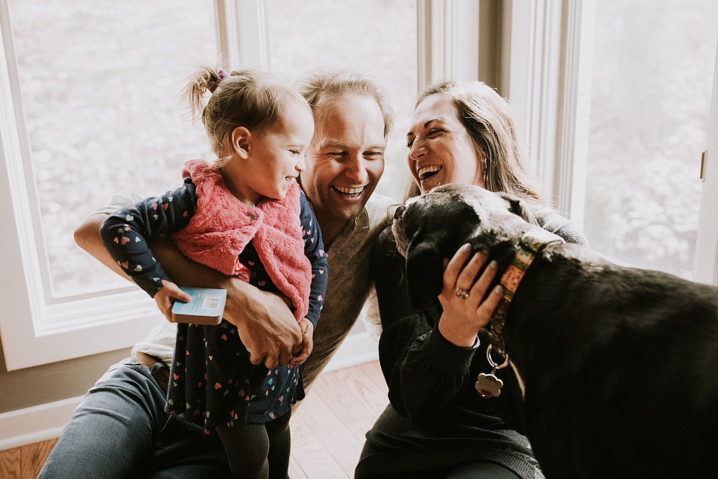 Family laughing all together in portrait