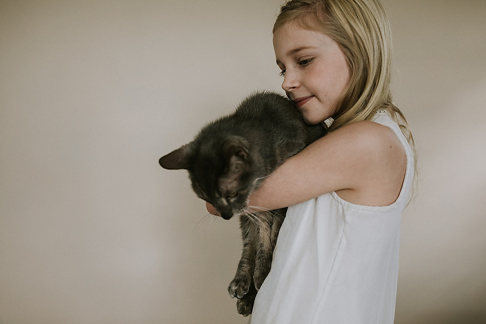 Girl carrying a cat