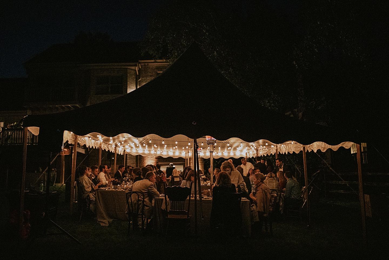 Wedding reception in backyard tent