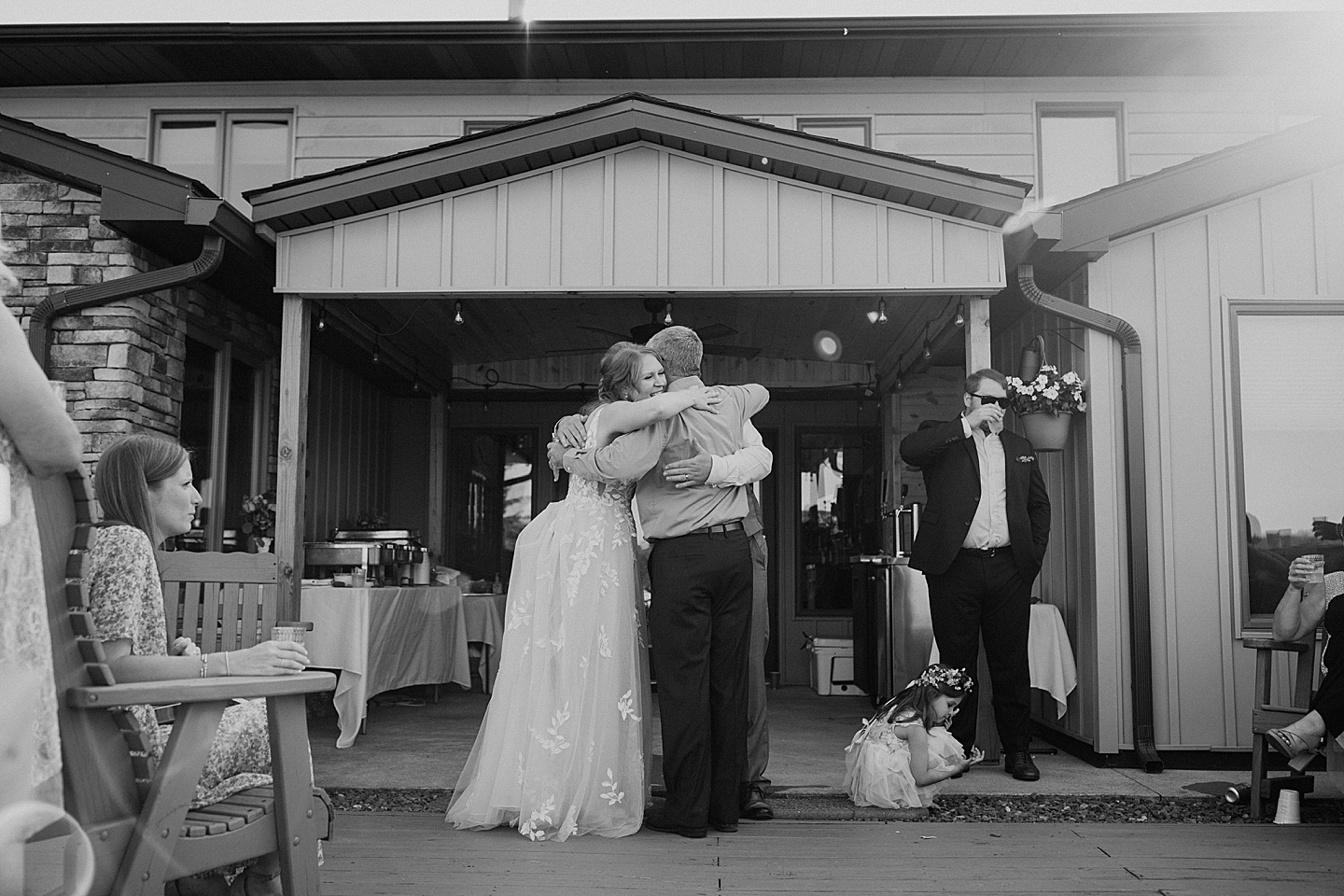 Family hugging after toasts at wedding