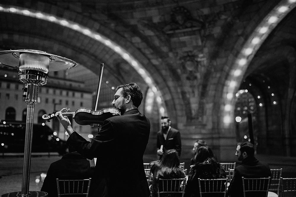 Violinist performing before wedding