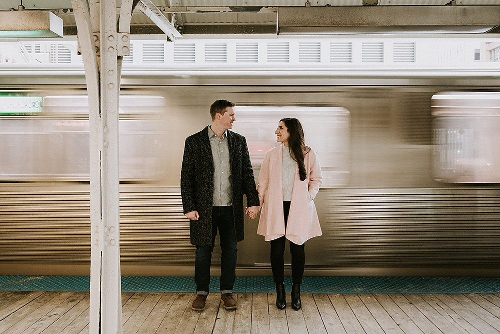 Couple standing near the L in Chicago