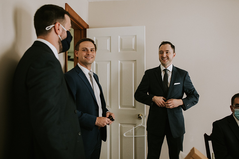 Groom getting dressed before Pittsburgh backyard wedding