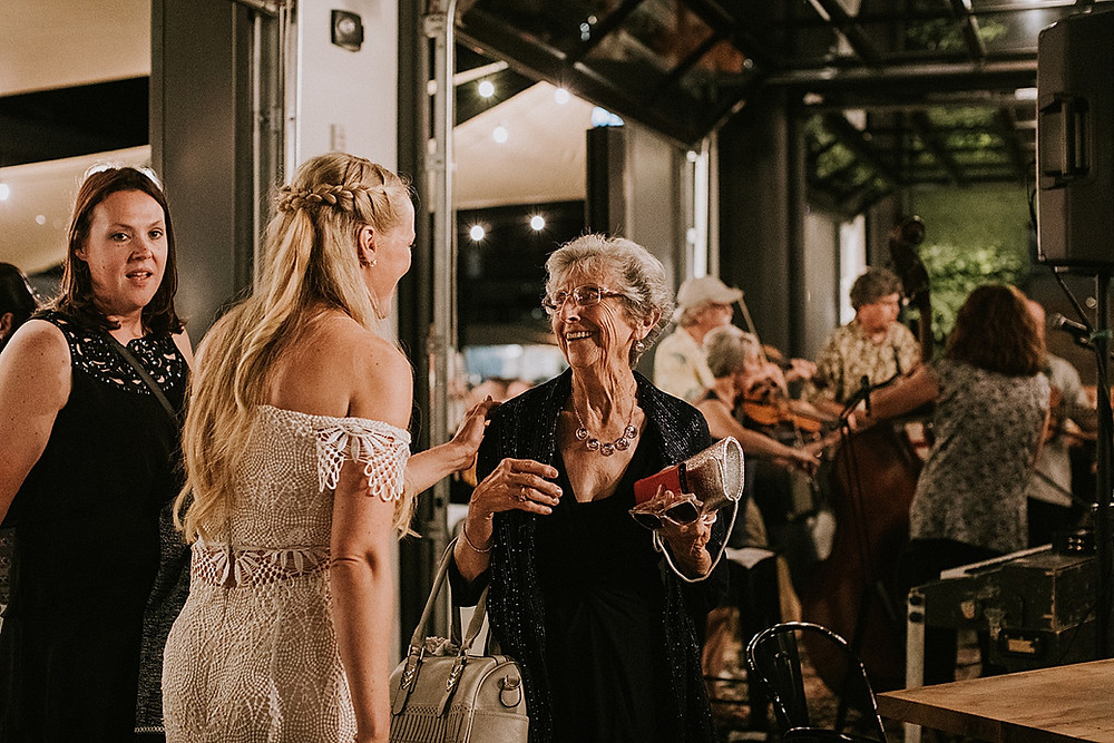 Bride talking to guest at a wedding