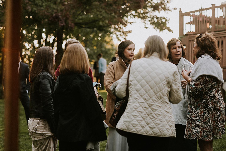 Guests talking at wedding