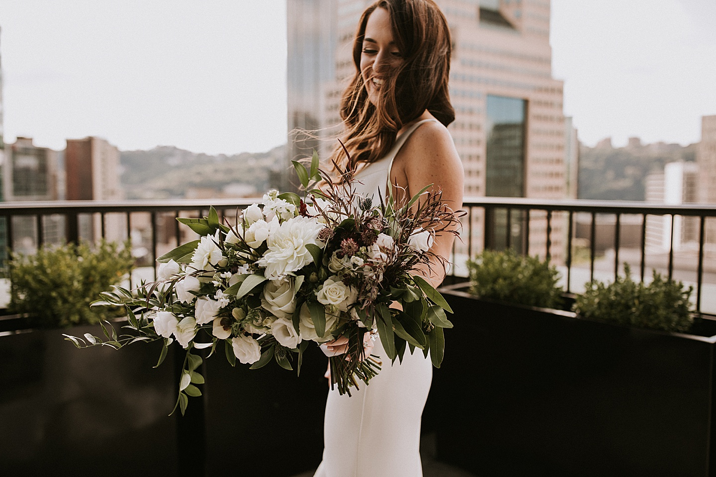 Bride with bouquet of flowers in Pittsburgh, PA