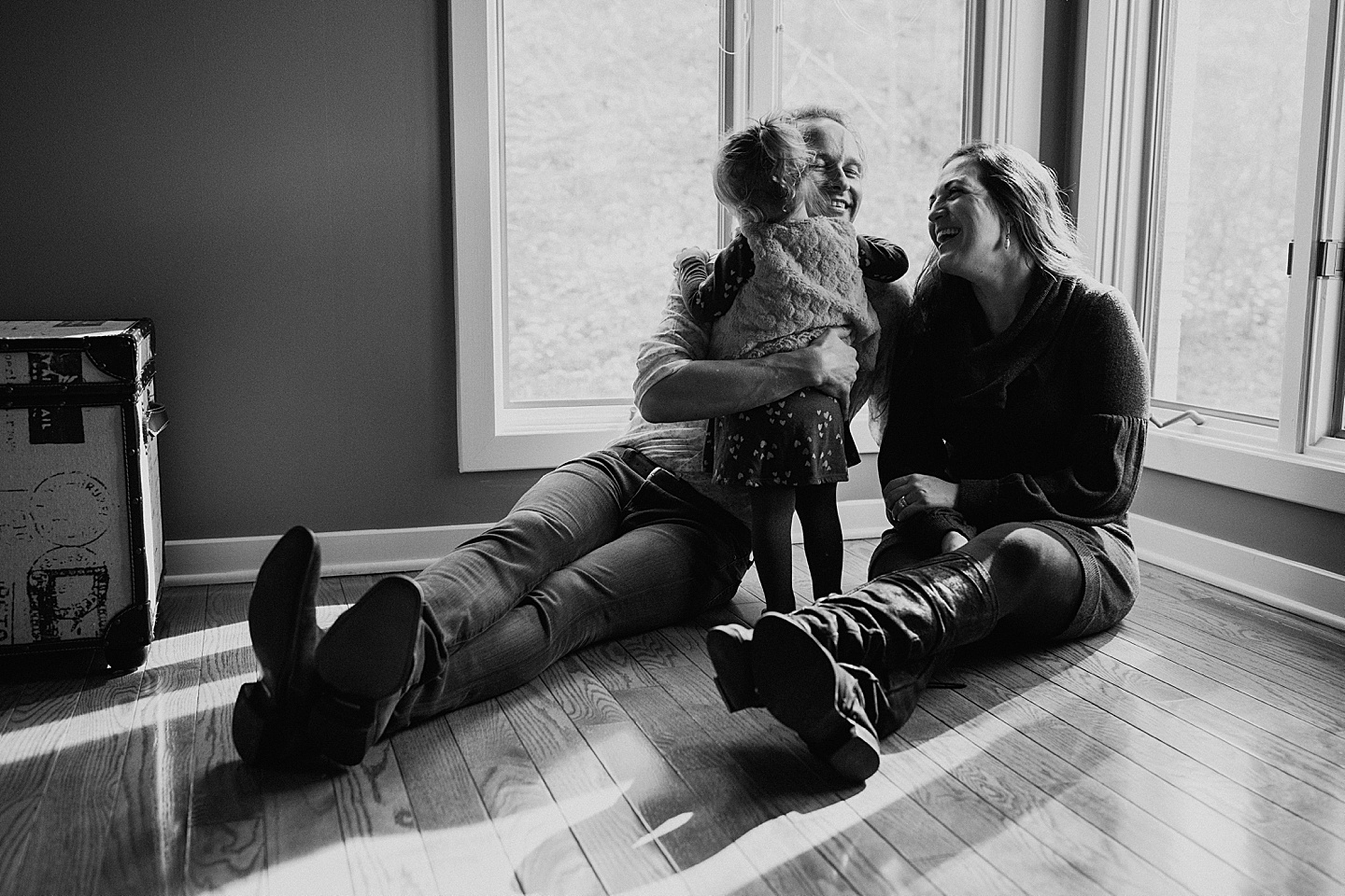 Parents laughing with their daughter