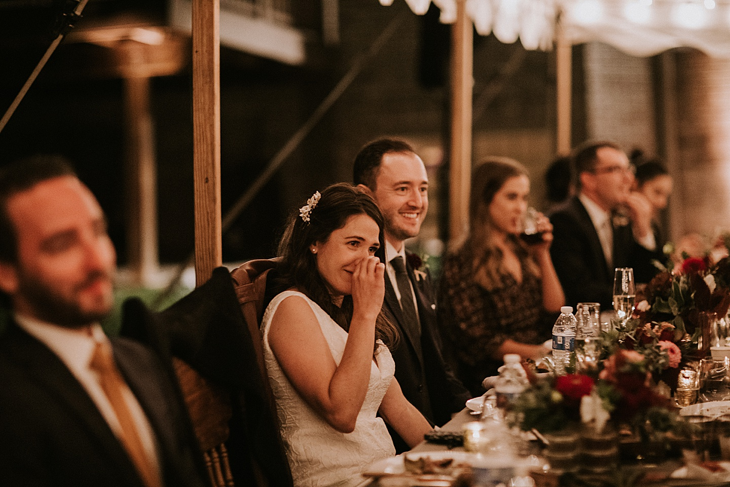 Couple laughing at wedding toast