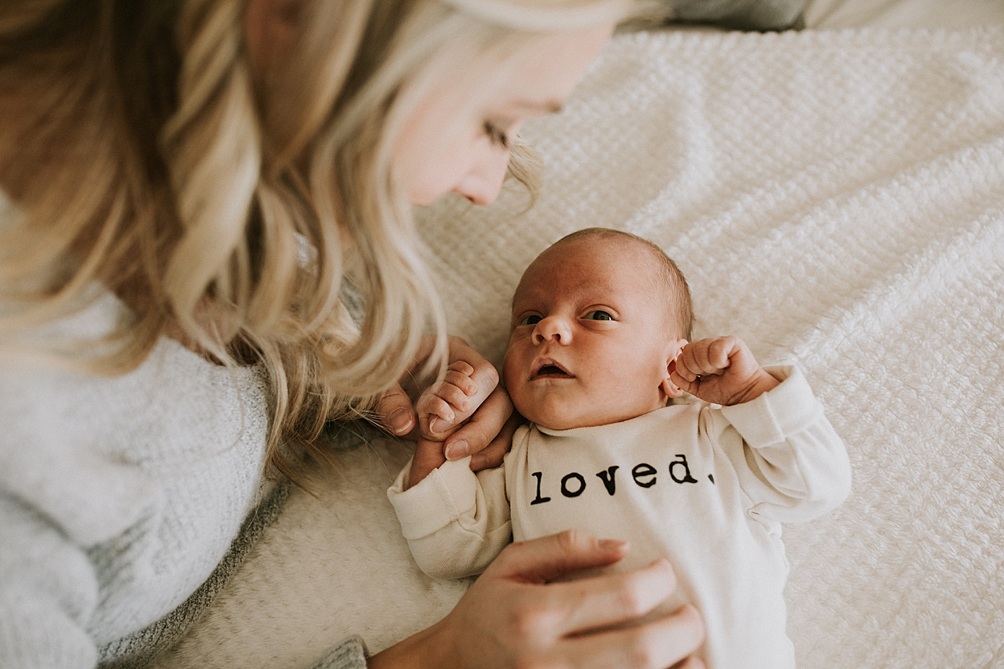 Mom with newborn on bed