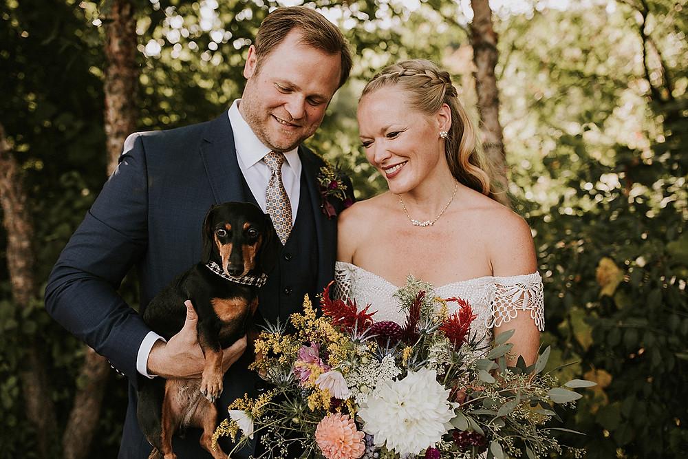 Wedding couple and their weiner dog
