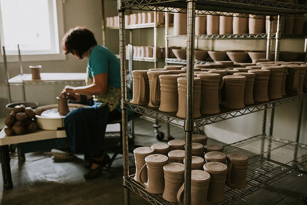 Woman working in a ceramics shop