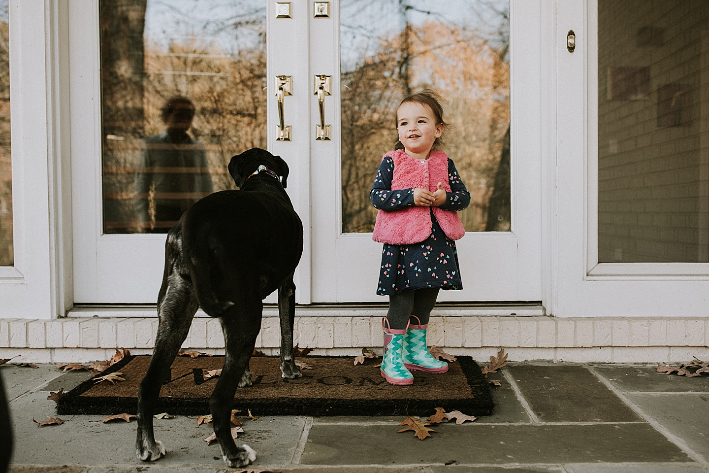 Toddler with her dog