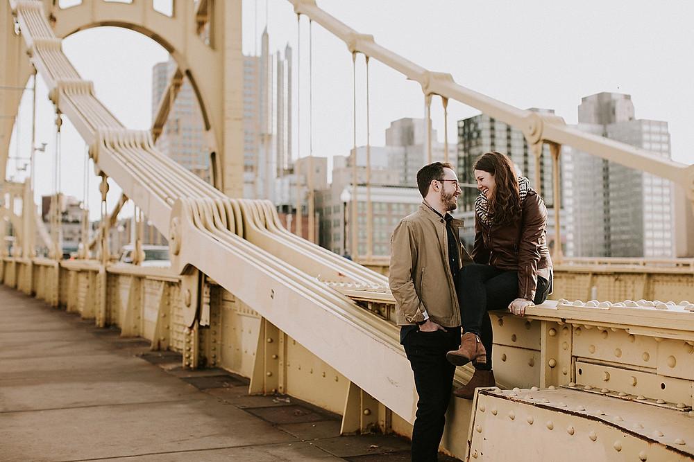 Couple sitting on bridge in Pittsburgh