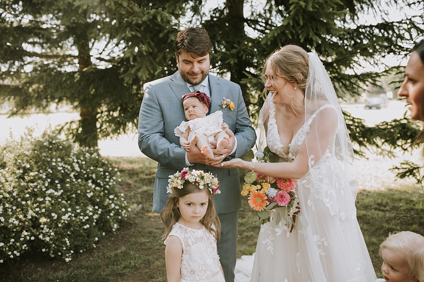 Bride and groom portraits with flower girls and kids