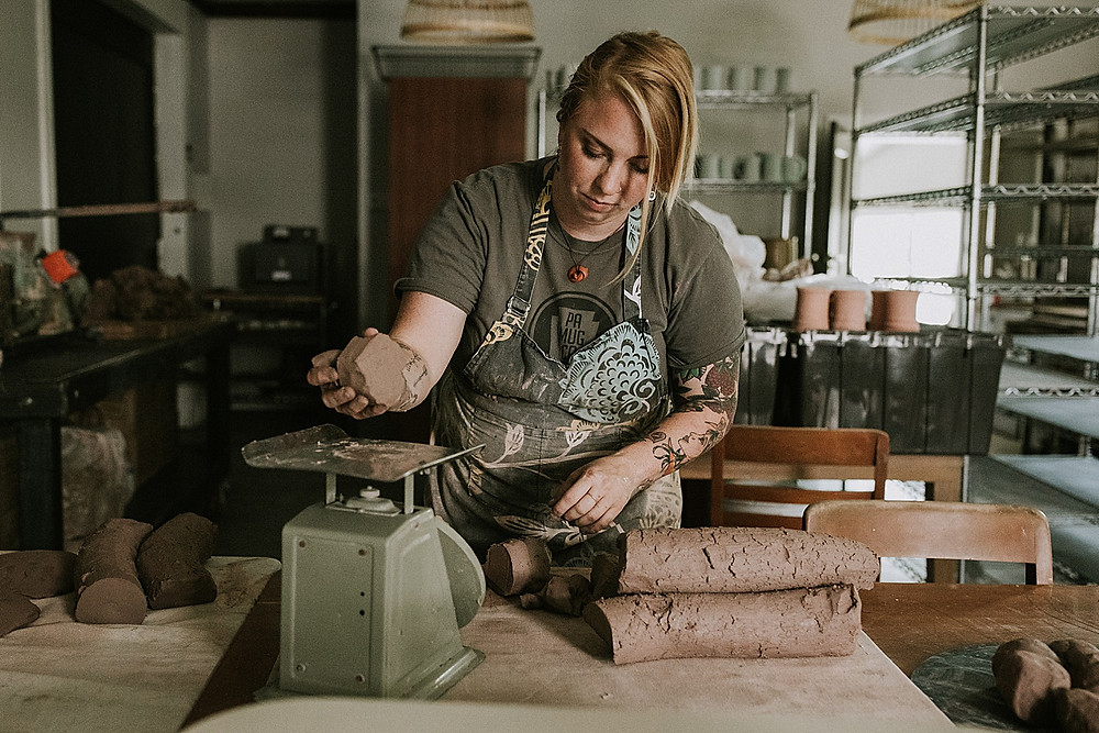 Woman working with clay on a table