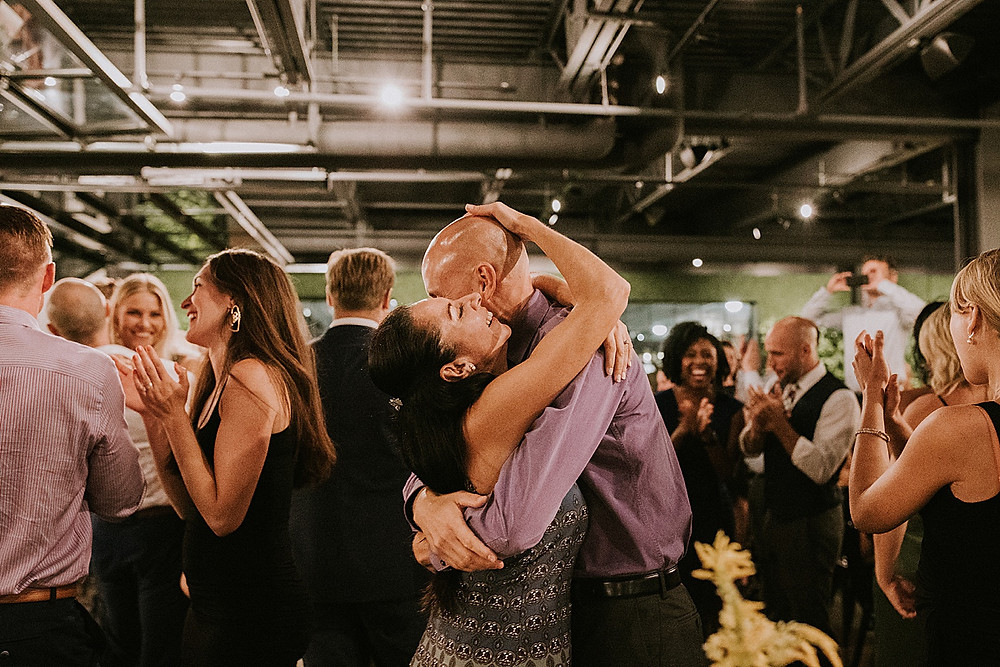 Couple hugging on dance floor