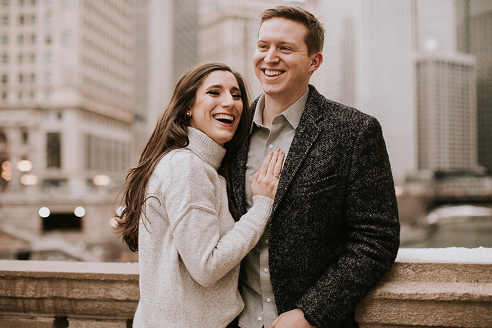 Man and woman laughing during photos