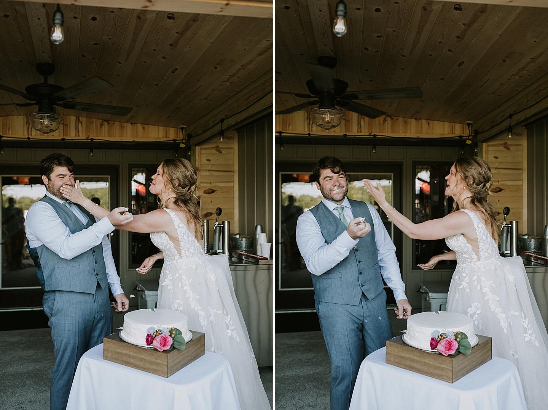 Bride smashing cake in groom's face