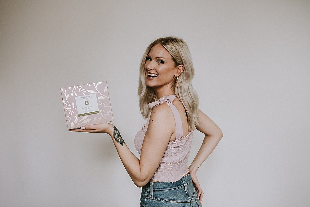 Model holding a box of skin care products
