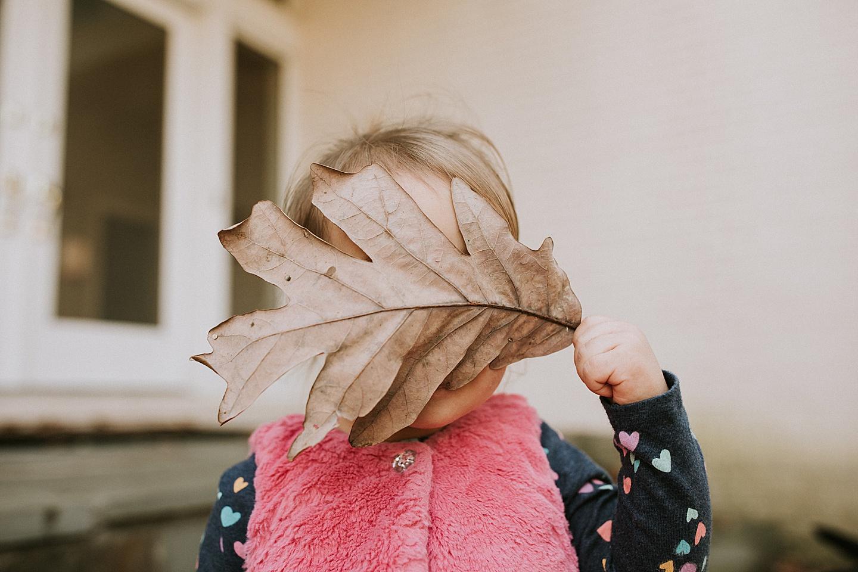 Toddler holding a leaf