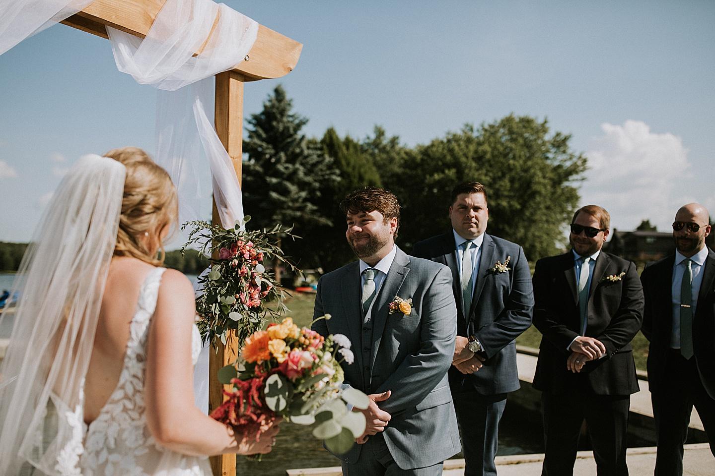 Groom smiling at bride during wedding