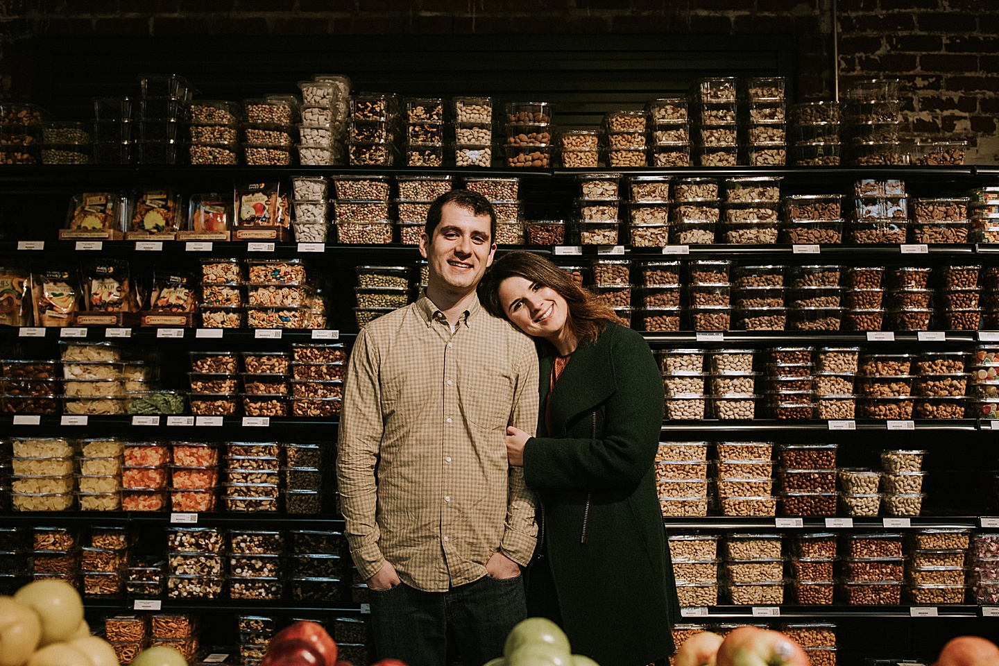 Engagement portrait in a grocery store