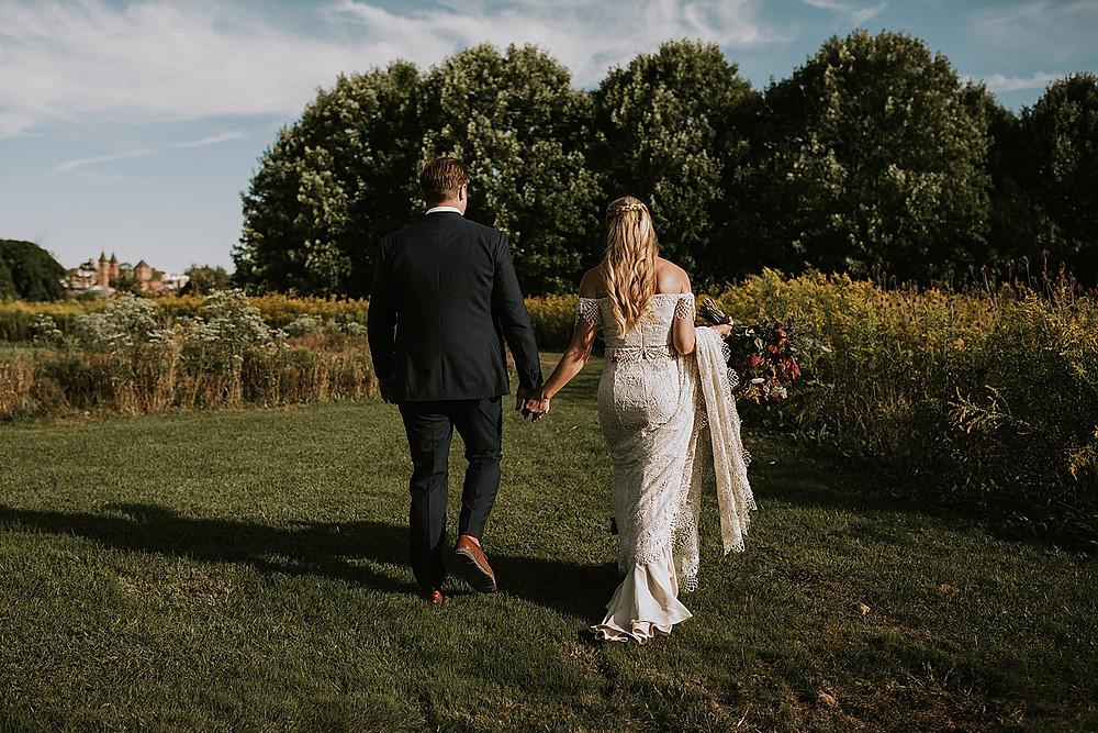 Couple walking through a garden