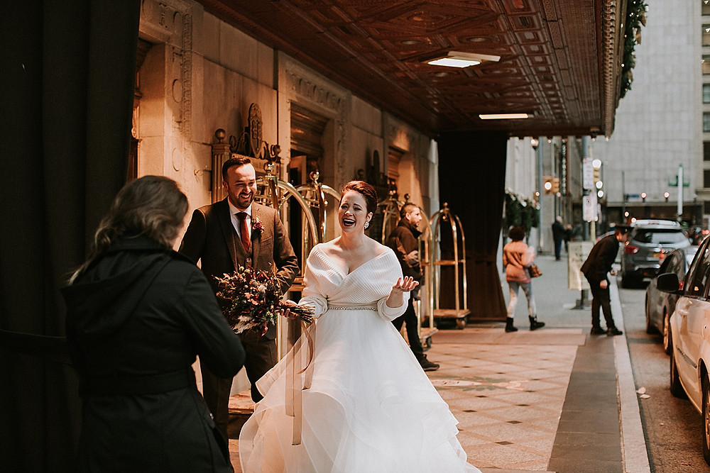 Bride laughing outside wedding