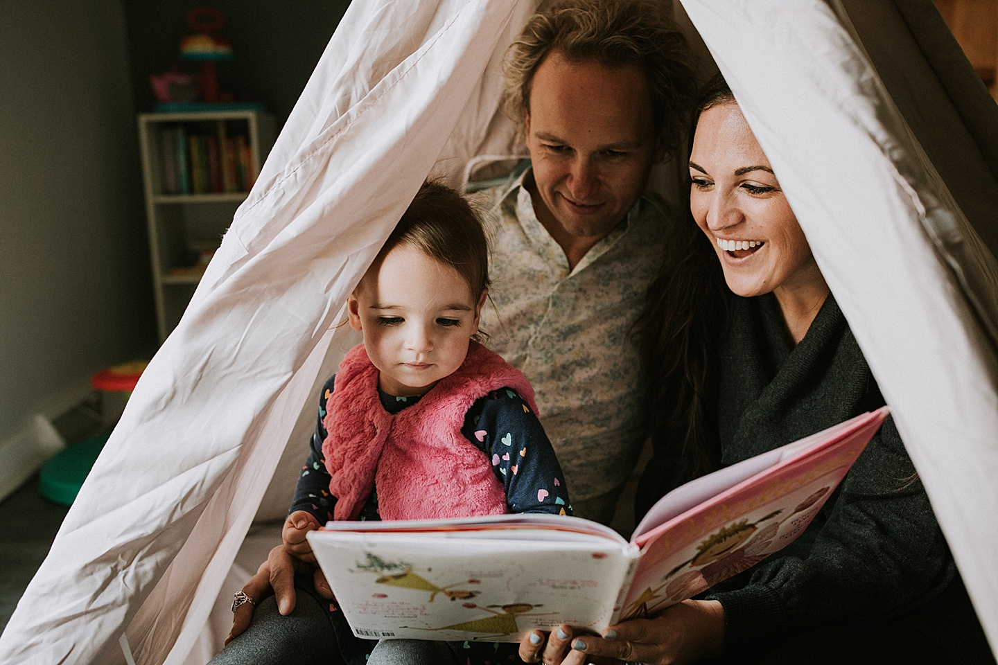 Family reading in tent