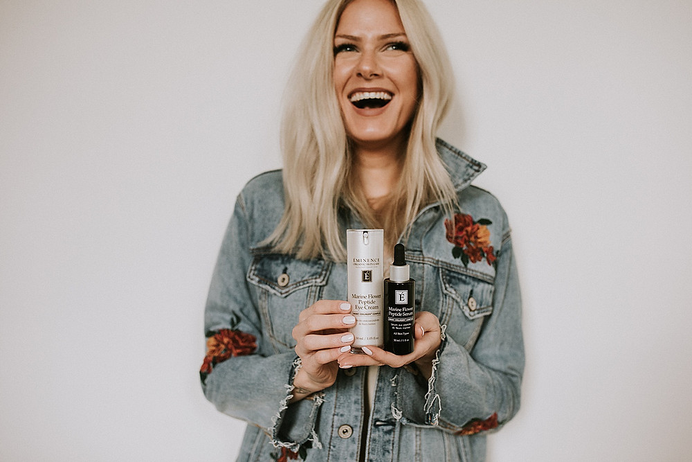 Model holding skin care products