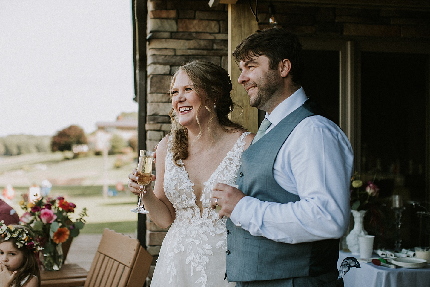 Bride and groom smiling during toasts