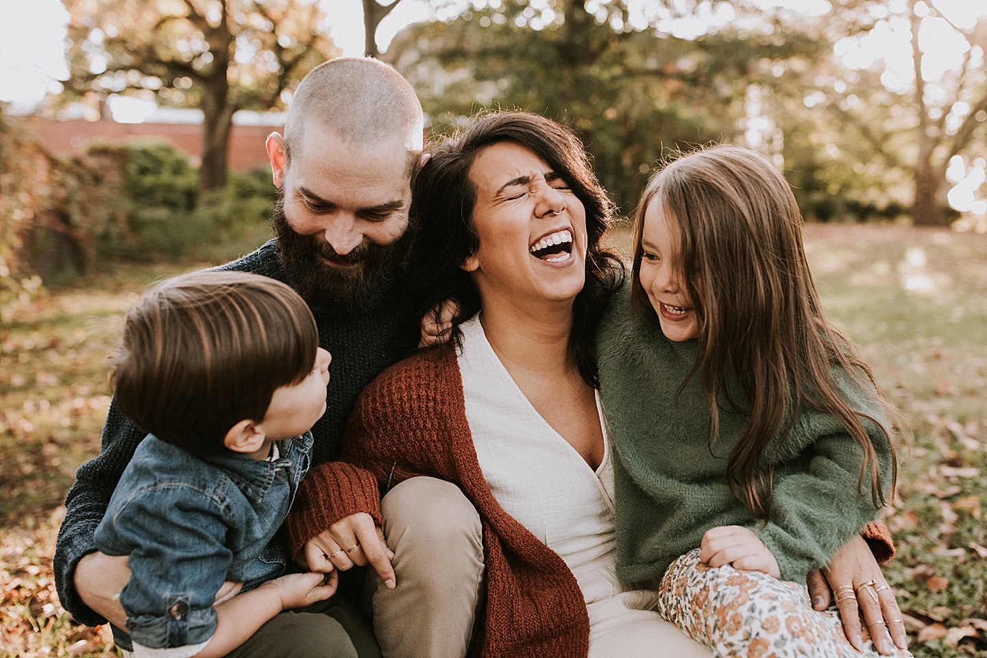 Family laughing during portrait session