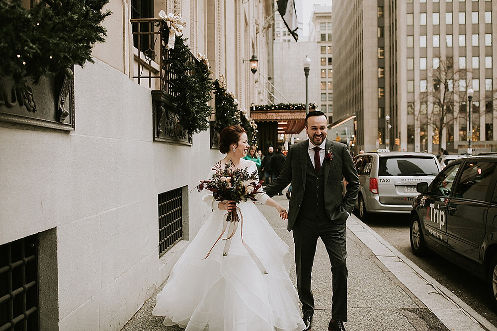 Bride and groom walking in downtown Pittsburgh