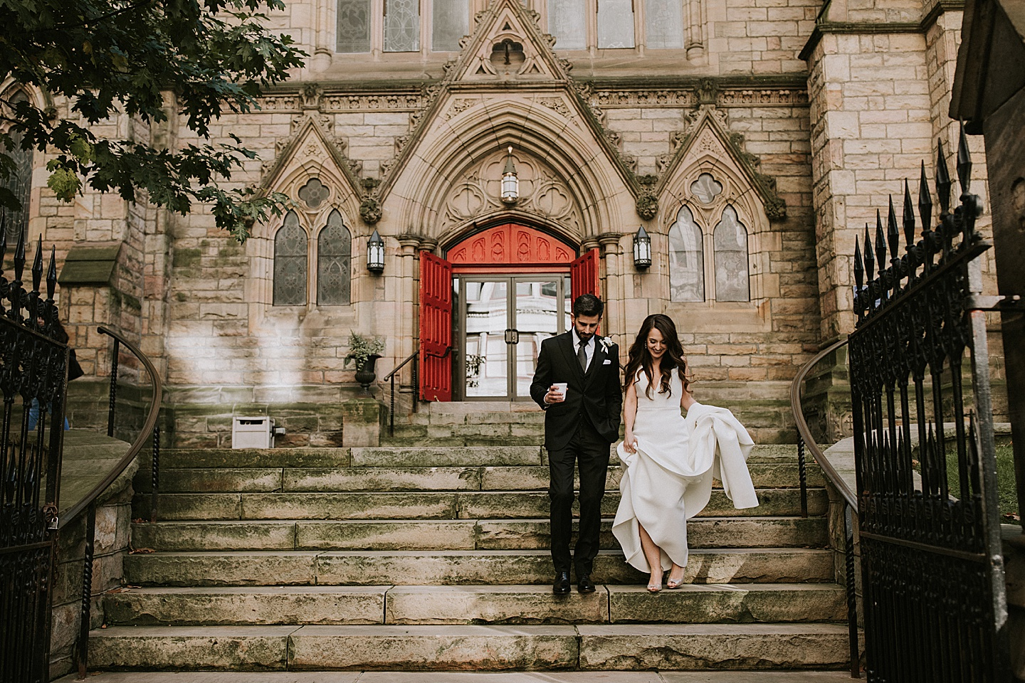Couple walking down the stairs of the church