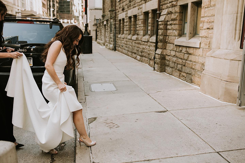 Bride stepping onto curb