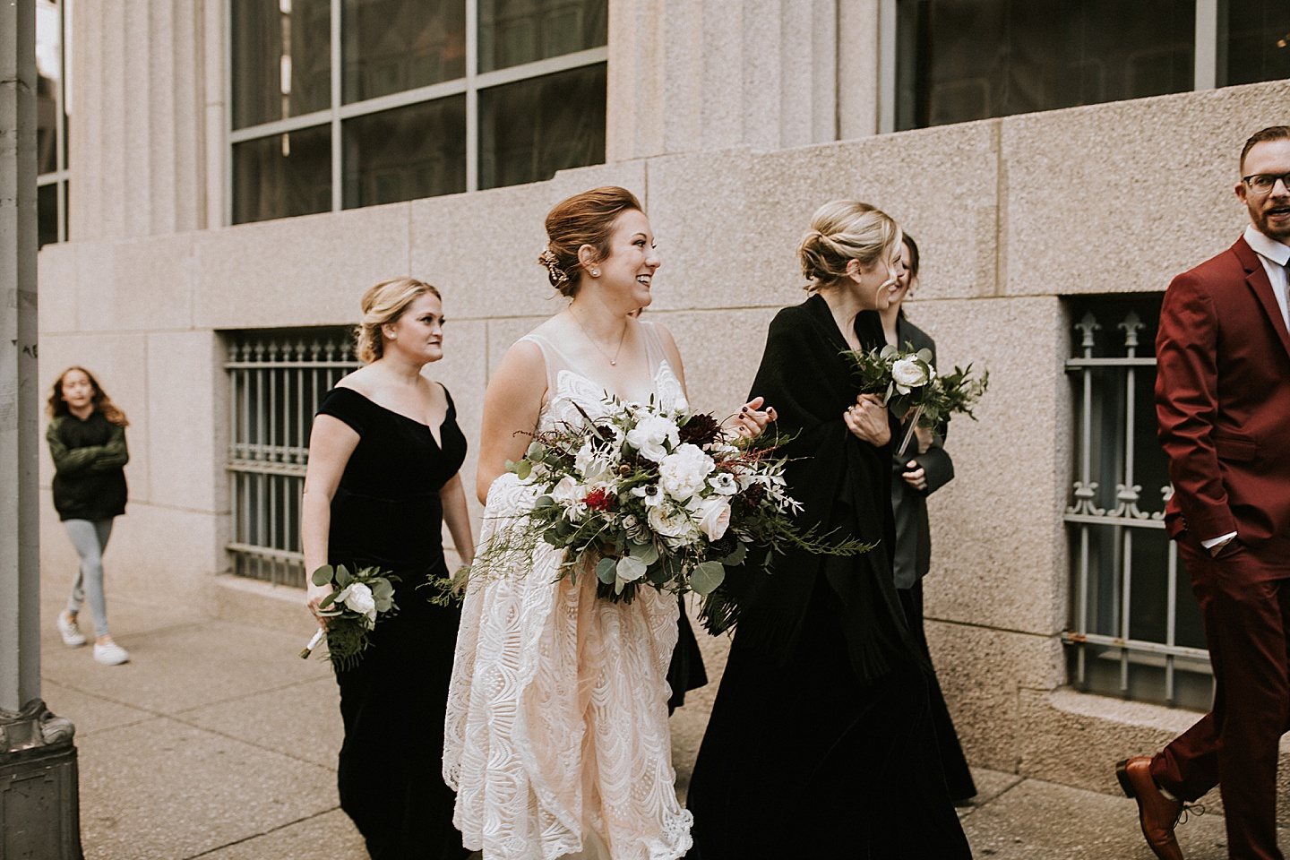 Bridal party walking downtown