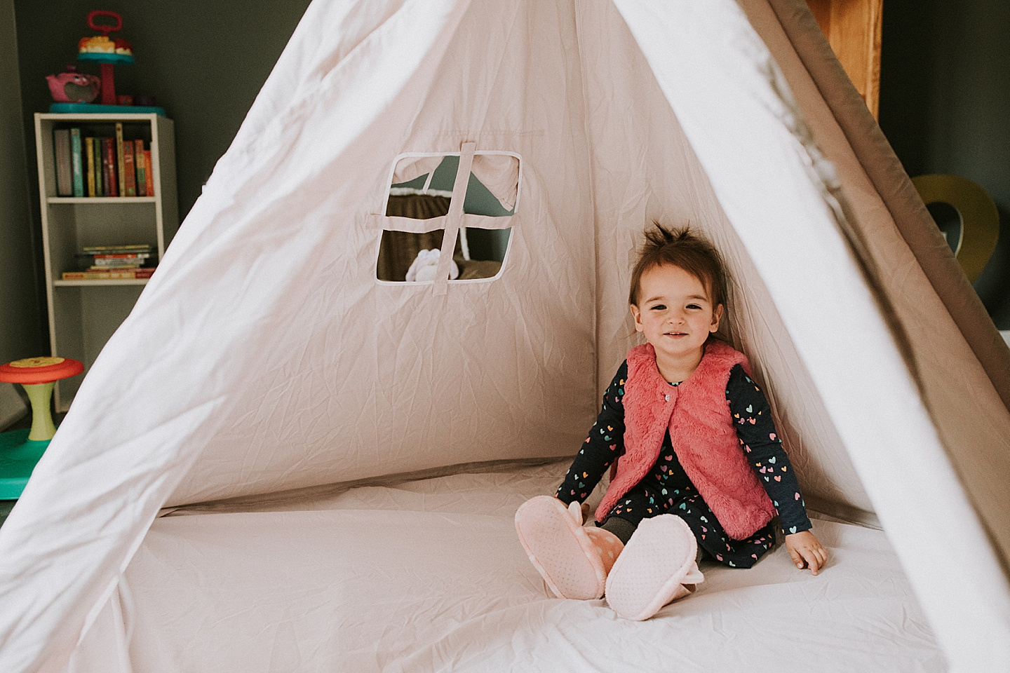 Toddler sitting in tent