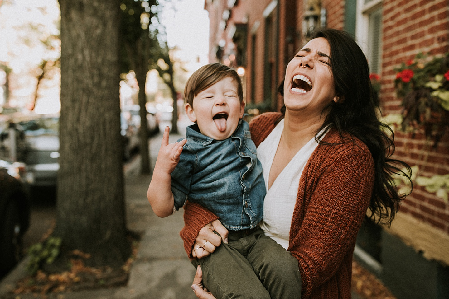 Mother laughing at toddler portrait