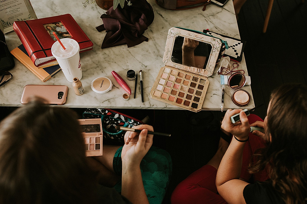 Bridesmaids doing their makeup